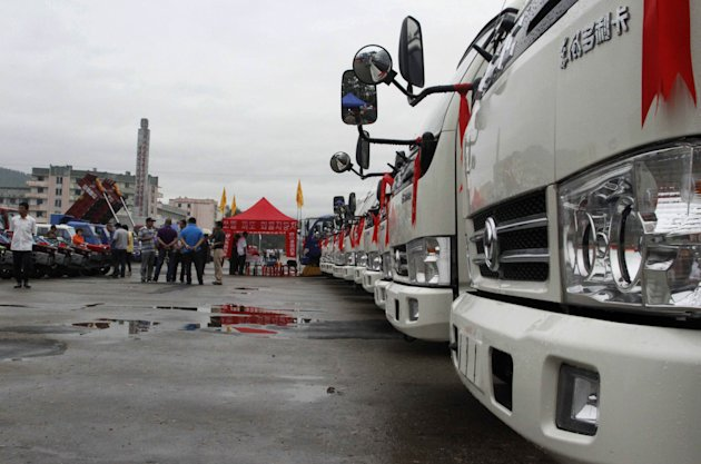 Trucks are exhibited at the 2nd Rason International Trade Fair in Rason, North Korea, Monday, Aug. 20, 2012. North Korea is staging its second international trade fair in the special economic zone of Rason this week just days after a top official went to China to drum up support for the region. (AP Photo/Kim Kwang Hyon)