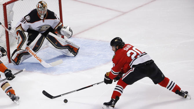 Chicago Blackhawks left wing Brandon Saad (20) shoots on Anaheim Ducks goalie Frederik Andersen (31) during the first period in Game 6 of the Western Conference finals of the NHL hockey Stanley Cup playoffs, Wednesday, May 27, 2015, in Chicago. (AP Photo/Charles Rex Arbogast)