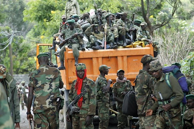 M23 rebels withdraw from the eastern Congo town of Goma, Saturday Dec. 1, 2012. Sy Koumbo, a spokesman for the U.N. in Congo, says that an agreement was reached late Friday with M23 rebels after they attempted to force their way into Goma&#39;s international airport to seize arms. Koumbo says U.N. peacekeepers blocked the fighters. Trucks full of M23 rebels drove Saturday along the road that leads out of Goma towards Kibumba, where the rebels are supposed to settle following an agreement reached in Kampala last week. M23 soldiers were cheering as they did a final tour in the city center. (AP Photo/Jerome Delay)