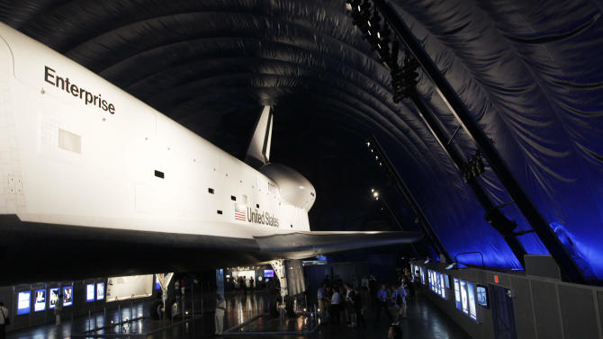 The Space Shuttle Enterprise sits on display at the Sea, Air and Space Museum's Space Shuttle Pavilion Wednesday, July 18, 2012, in New York. The Pavilion will be open to the public Thursday, July 19, 2012. (AP Photo/Frank Franklin II)