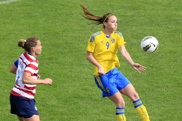 Sweden's Kosovare Aslanni controls a ball ahead of Christie Rampone of the U.S. during their women's Algarve Cup soccer match at the Lagos city stadium in southern Portugal