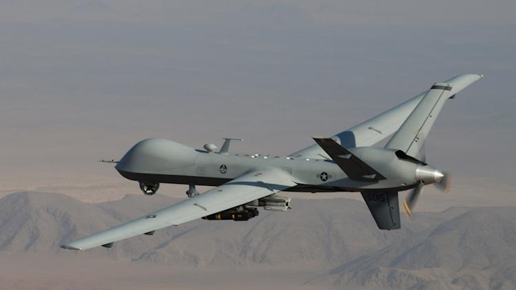 This undated handout photo provided by the U.S. Air Force shows a MQ-9 Reaper, armed with GBU-12 Paveway II laser guided munitions and AGM-114 Hellfire missiles, piloted by Col. Lex Turner during a combat mission over southern Afghanistan. U.S. and Pakistani officials say Pakistan's intelligence chief will head to Washington late this month to resume counterterrorism talks suspended over a deadly border incident last year that killed two dozen Pakistani troops.  (AP Photo/Lt. Col.. Leslie Pratt, US Air Force)