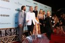 Director Luhrmann poses for pictures with cast members on the red carpet of the Australian premiere of