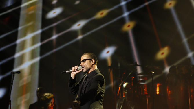 Brittish singer George Michael performs during his first Symphonica concert at the State Opera House in Prague, Czech Republic, Monday, Aug. 22, 2011. (AP Photo/Petr David Josek)