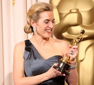 Know what would be even better than this gold tropy, thinks Kate Winslet, a life-sized, flesh-toned version. (Getty Images)