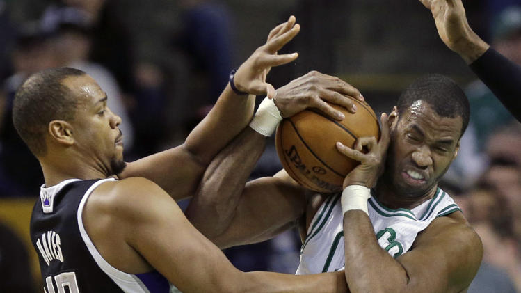 "FILE - In this Jan. 30, 2013, file photo, Boston Celtics center Jason Collins, right, struggles for control of the ball with Sacramento Kings forward Chuck Hayes (42) during the second half of an NBA basketball game in Boston. ESPN says that it regrets the ""distraction"" caused by one of its reporters who described Jason Collins as a sinner after the NBA center publicly revealed that he was gay. Chris Broussard, who covers the NBA for ESPN, had said on the air that Collins and others in the NBA who engage in premarital sex or adultery were ""walking in open rebellion to God, and to Jesus Christ.""  (AP Photo/Elise Amendola, File)"