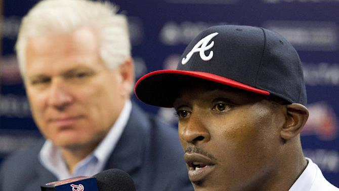 Atlanta Braves newly-signed center fielder B.J. Upton, right, speaks as general manager Frank Wren looks on  during a news conference, Thursday, Nov. 29, 2012, in Atlanta. Upton, who was introduced during the news conference, replaces free agent Michael Bourn in center field and should provide needed power from the right side. (AP Photo/John Bazemore)