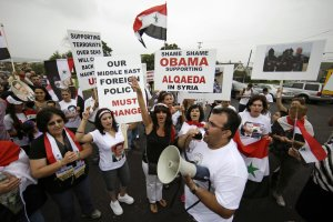 Members of the local Syrian community march in protest …