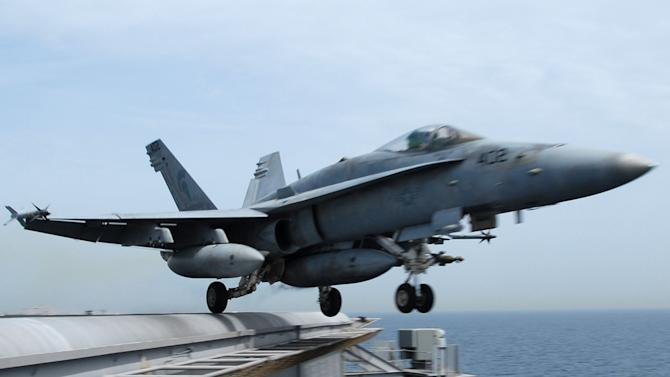 CORRECTS MISSING PLANE TO U.S. MARINES  FIGHTER JET - FILE - This image provided by the US Navy shows an F/A-18C Hornet launching from the Nimitz-class aircraft carrier USS John C. Stennis (CVN 74) in this March 27, 2007 file photo. A U.S. Coast Guard spokesman says military officials are searching for a U.S. Marine Corps fighter jet similar to this one shown  that went missing Wednesday Aug. 10, 2011 over the Pacific Ocean near San Diego.  (AP Photo/US Navy photo - Paul J. Perkins, File)