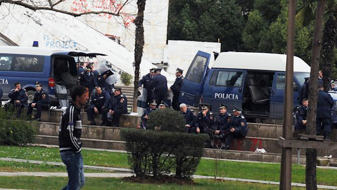 A man walks past an increased police presence outside the main government building in Tirana, Albania, Friday, Feb. 18, 2011, ahead of the anti-government protest to demand the government's resignation over corruption allegations. (AP Photo/Hektor Pustina)