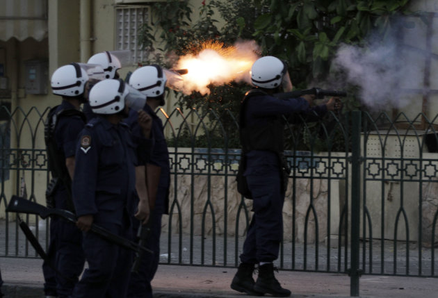 Riot police fire tear gas toward Bahraini anti-government protesters, unseen, during clashes Thursday, May 17, 2012, in Bilad al-Qadeem, Bahrain, on the edge of the capital of Manama. (AP Photo/Hasan Jamali)