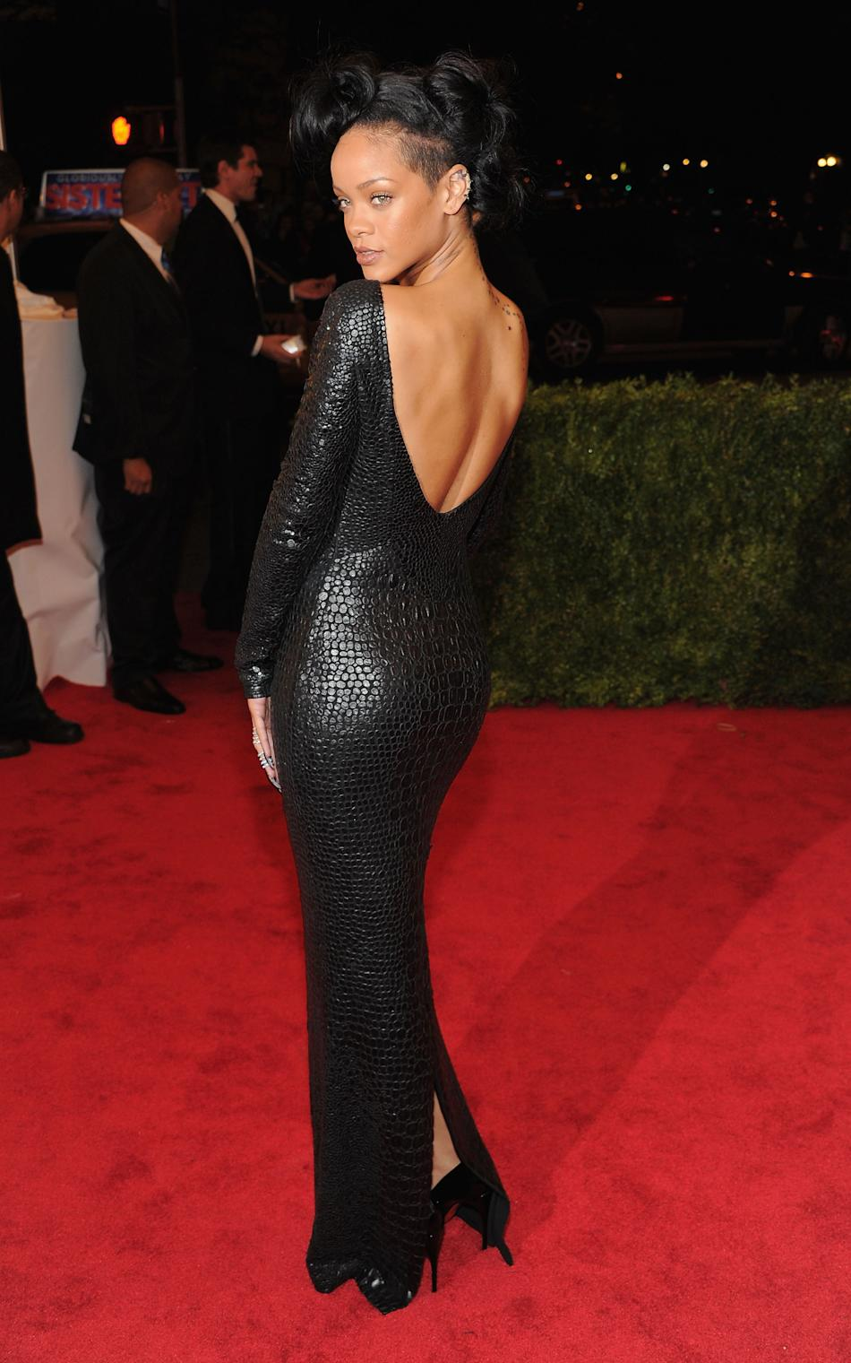 Yes, you're looking at a backless crocodile Tom Ford gown. This happened at the 2012 Met Gala and Rihanna wore it like a glove. (Larry Busacca/WireImage)