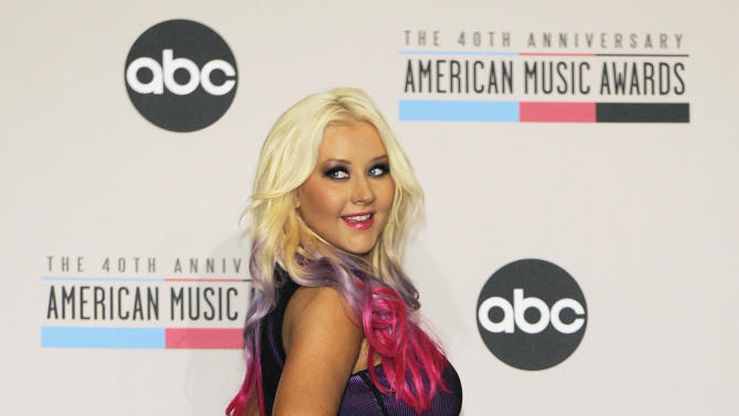 Singer Christina Aguilera poses after announcing nominations for the 2012 American Music Awards at the J.W. Marriott L.A. Live on Tuesday, Oct. 9, 2012, in Los Angeles. The 40th Anniversary American Music Awards will be held on November 18 at the Nokia Theatre in Los Angeles. (Photo by Chris Pizzello/Invision/AP)