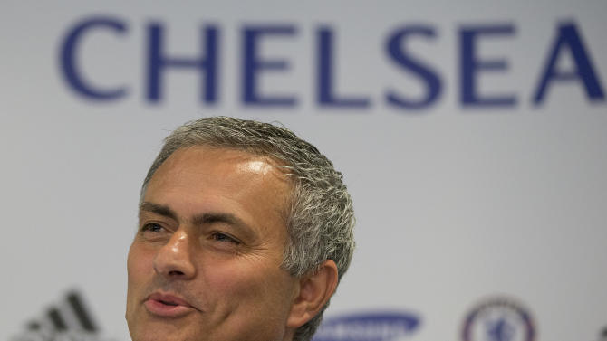 Chelsea's new coach Jose Mourinho speaks to the media during a press conference at Chelsea's Stamford Bridge stadium in London, Monday June 10, 2013. Mourinho has been reappointed coach to the team for the second time. (AP Photo/Alastair Grant)