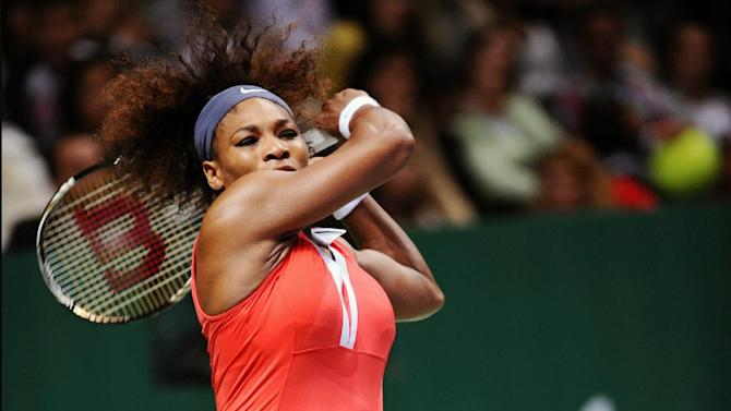 Serena Williams of the US returns a shot to Na Li of China during their tennis match on the second day of the WTA championship in Istanbul, Turkey, Wednesday, Oct. 24, 2012. (AP Photo)