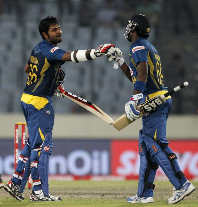 Sri Lanka's Mathews congratulates Thirimanne after he scored a century against Pakistan during their 2014 Asia Cup final cricket match in Dhaka