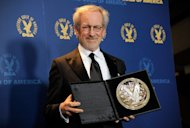 Steven Spielberg poses backstage with his feature film nomination plaque for &quot;Lincoln&quot; at the 65th Annual Directors Guild of America Awards at the Ray Dolby Ballroom on Saturday, Feb. 2, 2013, in Los Angeles. (Photo by Chris Pizzello/Invision/AP)