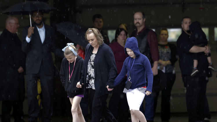 Mourners leave a funeral service for Antonia Calendaria, 9, a student at Towers Plaza Elementary school who was killed by Monday's tornado Thursday, May 23, 2013, in Oklahoma City, Oklahoma. (AP Photo/Tony Gutierrez)
