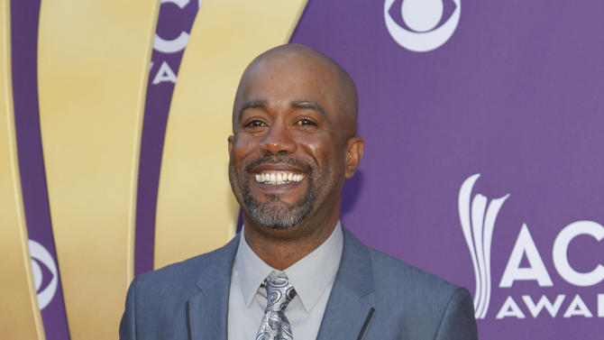 FILE - In this April 1, 2012 file photo, Darius Rucker arrives at the 47th Annual Academy of Country Music Awards in Las Vegas. Rucker was surprised Tuesday night, Oct. 2, 2012 by Brad Paisley, who invited Rucker to become a member of the Grand Ole Opry. (AP Photo/Isaac Brekken, File)