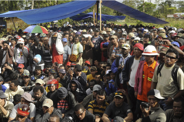 Workers of mining giant Freeport-McMoran gather during a strike in Timika, Papua province, Indonesia, Friday, Sept. 16, 2011. Thousands of workers at Freeport-McMoran's gold and copper mine in eastern