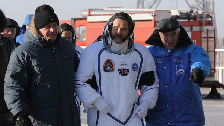 Canadian astronaut Chris Hadfield, crew member of the mission to the International Space Station, ISS, walks to the rocket prior the launch of Soyuz-FG  rocket at the Russian leased Baikonur cosmodrome, Kazakhstan, Wednesday, Dec. 19, 2012.  (AP Photo/Dmitry Lovetsky, pool)