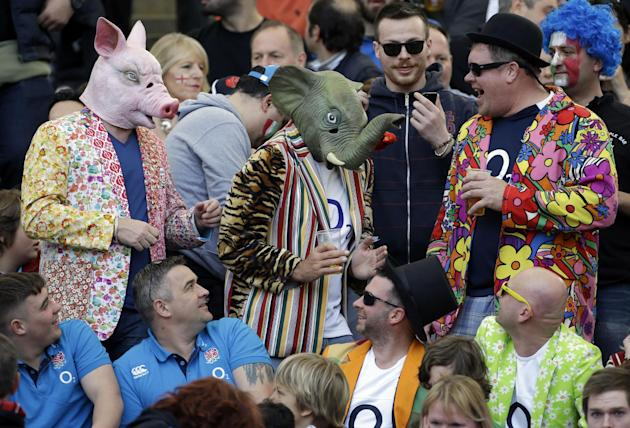 England fans, some wearing masks of a pig and an elephant, wait for the start of the Six Nations Rugby Union match between Italy and England at Rome's Olympic stadium, Saturday, March 15, 2014