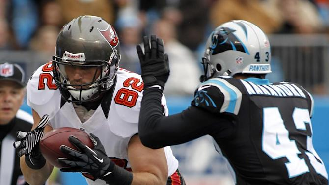 Tampa Bay Buccaneers' Nate Byham (82) catches a touchdown pass against Carolina Panthers' Haruki Nakamura (43) during the first half of an NFL football game in Charlotte, N.C., Sunday, Nov. 18, 2012. (AP Photo/Bob Leverone)
