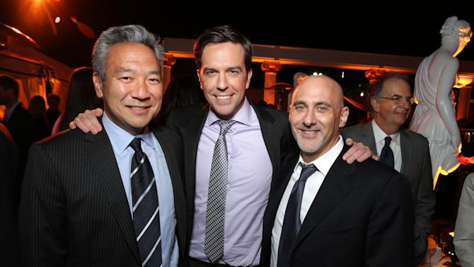 Warner Bros.' Kevin Tsujihara, Ed Helms and Warner Bros.' Jeff Robinov arrive at Warner Bros. Premiere of The Hangover: Part III, on Monday, May, 20, 2013 in Los Angeles. (Photo by Eric Charbonneau/Invision for Warner Bros./AP Images)