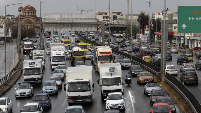 Cars are caught in a traffic jam during a strike by metro employees and work stoppage held by urban railway, metro, bus and trolley unions in Athens, Thursday, Jan. 24, 2013. Greece's conservative prime minister is holding emergency meeting after a deadline for striking public transport workers expired, leaving Athens' subway system closed for an eighth day. Strikers protesting pay cuts refused to return to work Thursday despite a court decision declaring their protest illegal. (AP Photo/Thanassis Stavrakis)