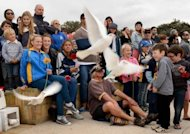 "Mourners release doves after a ceremony to commemorate the 10th anniversary of the 2002 Bali attacks on Coogee Beach in Sydney. Reflecting on the legacy of the 2002 attacks, John Howard, Australia's prime minister at the time of the attacks, praised the ""Australian spirit"" and said terror had brought Indonesia and Australia together in their determination to recover"