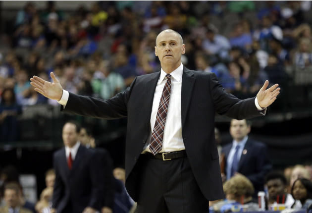 Dallas Mavericks head coach Rick Carlisle opens his arms while coaching from the sideline during the first half of an NBA preseason basketball game against the Orlando Magic in Dallas,  Monday, Oct. 1