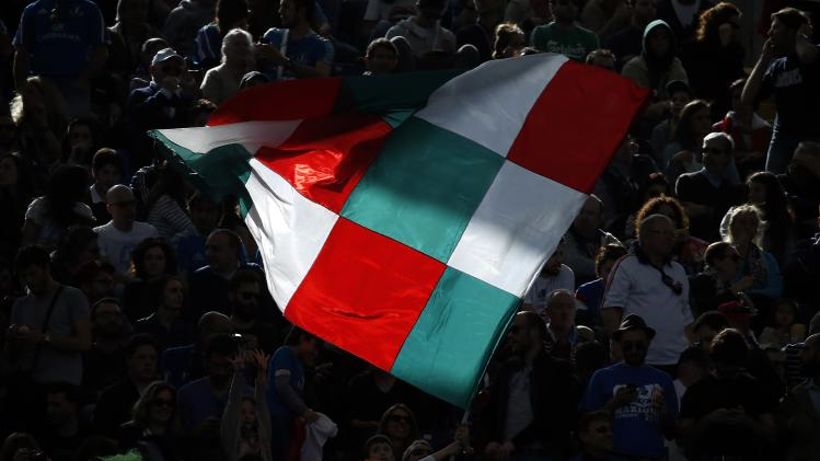 Italy's supporters wave flag during match against England in Six Nations rugby union match at Olympic Stadium in Rome
