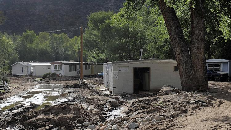Flood damage is seen at the River Bend Mobile Home Park in Lyons, Colo., on Thursday, Sept. 19, 2013. Hundreds of evacuees were allowed past National Guard roadblocks Thursday to find a scene of tangled power lines, downed utility poles, and mud-caked homes and vehicles. (AP Photo/Chris Schneider)