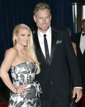 FILE - In this May 3, 2014, file photo, Jessica Simpson and Eric Johnson attend the White House Correspondents' Association Dinner at the Washington Hilton Hotel in Washington. Simpson is a newlywed. The singer and TV personality married retired NFL player Eric Johnson Saturday, July 6, 2014, at San Ysidro Ranch in Montecito, Calif., her publicist Lauren Auslander confirms. (Photo by Evan Agostini/Invision/AP, File)