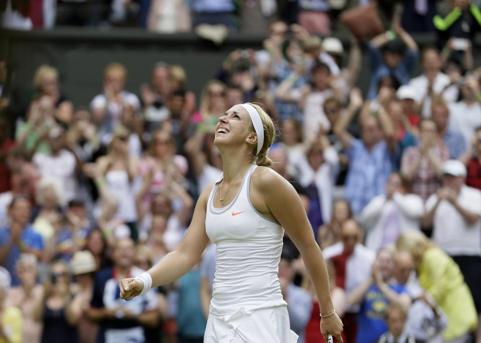 Sabine Lisicki of Germany reacts after beating Serena Williams of the United States in a Women's singles match at the All England Lawn Tennis Championships in Wimbledon, London, Monday, July 1, 2013. (AP Photo/Alastair Grant)