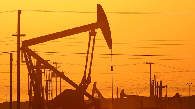 Pump jacks are seen at dawn in an oil field over the Monterey Shale formation, where gas and oil are extracted using hydraulic fracturing, or fracking, near Lost Hills, California, on March 24, 2014
