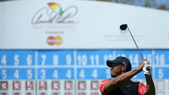 Tiger Woods watches his tee shot on the 15th hole during the final round of the Arnold Palmer Invitational golf tournament in Orlando, Fla., Monday, March 25, 2013. (AP Photo/Phelan M. Ebenhack)