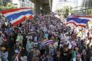 Anti-government protesters march in a rally in central Bangkok