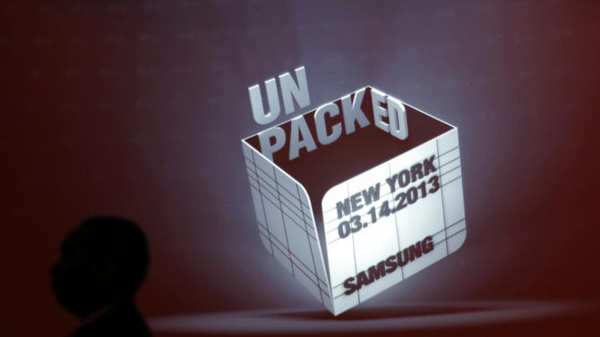 A security guard stands in front of a projected logo before the Samsung Unpacked event at Radio City Music Hall, Thursday, March 14, 2013 in New York. (AP Photo/Jason DeCrow)