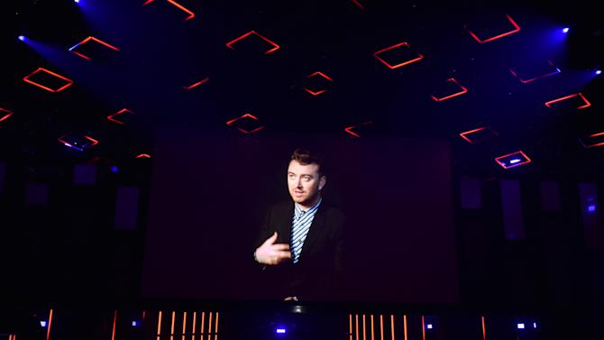Sam Smith appears on screen to accept the award for best new artist via satellite at the iHeartRadio Music Awards at The Shrine Auditorium on Sunday, March 29, 2015, in Los Angeles.  (Photo by John Shearer/Invision for iHeartRadio/AP Images)