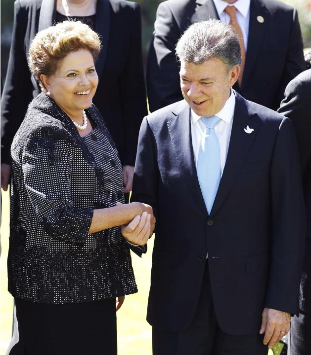 Brazil's president Rousseff speaks with Colombia`s president Santos after a meeting at Cerro Castillo Presidential Palace with Chilean president Bachelet in Vina del Mar city.