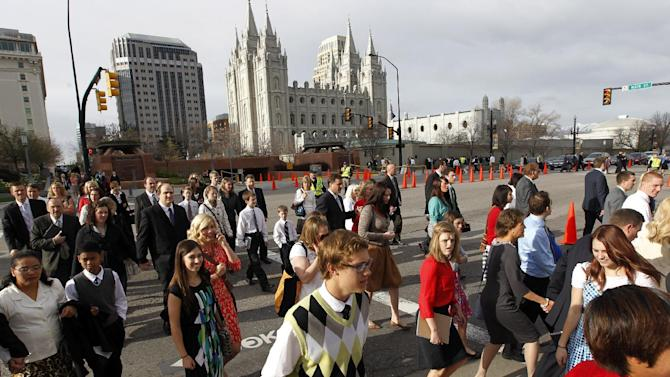 People walk to the Conference Center before the start of the 183rd Annual General Conference of The Church of Jesus Christ of Latter-day Saints on Saturday, April 6, 2013, in Salt Lake City.  The Church of Jesus Christ of Latter-day Saints is planning to build two new temples in Rio de Janeiro and Cedar City, Utah, the president of the Mormon church announced Saturday. Thomas S. Monson made the announcement in his opening address to more than 100,000 members of the church who've gathered in Salt Lake City for the church's 183rd semi-annual general conference.  (AP Photo/Rick Bowmer)