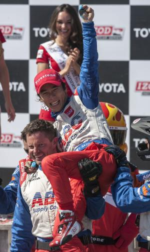 Takuma Sato of Japan celebrates after winning the IndyCar Series' Long Beach Grand Prix auto race, Sunday, April 21, 2013, in Long Beach, Calif. (AP Photo/Ringo H.W. Chiu)