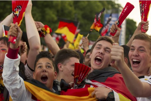 Fans celebrate after Germany scored against Netherlands during their Euro 2012 soccer match, at the Fan Mile in Berlin