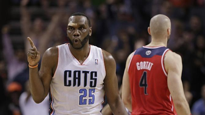Charlotte Bobcats' Al Jefferson (25) reacts after making a basket against the Washington Wizards during the second half of an NBA basketball game in Charlotte, N.C., Monday, March 31, 2014. The Bobcats won 100-94
