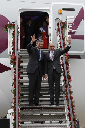 Qatar Airways CEO Akbar Al Baker, right, waves with Boeing Commercial Airplanes CEO Ray Connor as Qatar Airways unveil their Boeing 787 Dreamliner airplane during the Farnborough International Airshow, Farnborough, England, Monday, July 9, 2012. (AP Photo/Sang Tan)