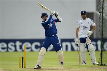 England's Root hits out watched by Cook during a training session before the second test cricket match against New Zealand at Headingley cricket ground in Leeds