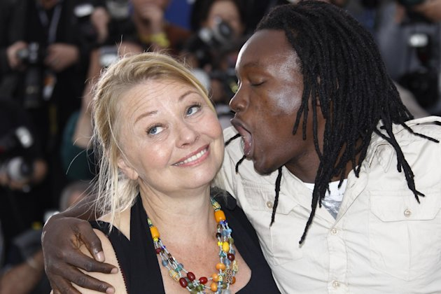 Actors Margarethe Tiesl, left and Peter Kazungu pose during a photo call for Paradise: Love at the 65th international film festival, in Cannes, southern France, Friday, May 18, 2012. (AP Photo/Joel Ryan)