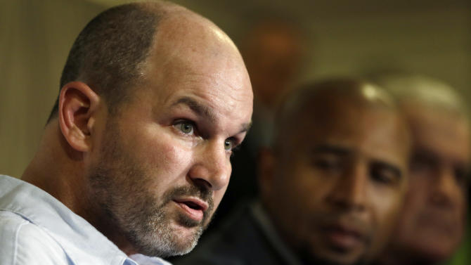 Former NFL player Kevin Turner, left, speaks as former players Dorsey Levens, center, and Bill Bergey listen during a a news conference Tuesday, April 9, 2013, in Philadelphia, after a hearing to determine whether the NFL faces years of litigation over concussion-related brain injuries. Thousands of former players have accused league officials of concealing what they knew about the risk of playing after a concussion. The lawsuits allege the league glorified violence as the game became a $9 billion-a-year industry. (AP Photo/Matt Rourke)