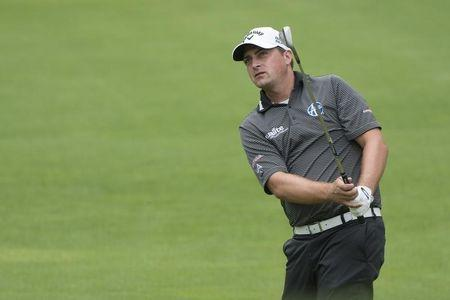 Stuard sets early pace in rainy New Orleans